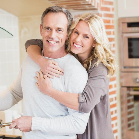 Smiling man and woman in kitchen
