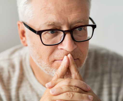 Man with glasses concentrating