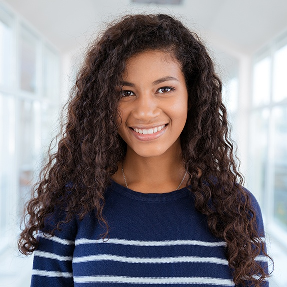 Young woman sharing healthy smile