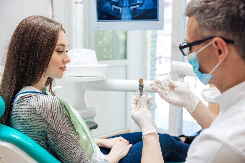 Dentist explaining dental implants to patient